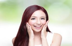 korean woman smiling after facial liposuction atlanta ga