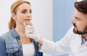 woman with a doctor checking her skin