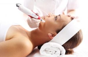 Woman undergoing microneedling facial treatment