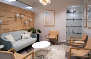 A waiting area and a display shelf with skincare products offered for sale at Kalos Facial Plastic Surgery, LLC in Atlanta GA.