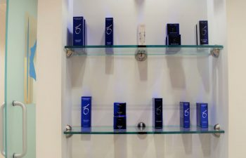 A display shelf with skincare products offered for sale at Kalos Facial Plastic Surgery, LLC in Atlanta GA.